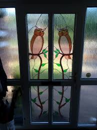 owl leaded design in a pvc door