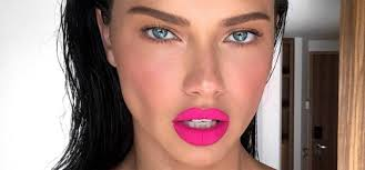 80s makeup is back here s how to wear blue eyeshadow and fuchsia lipstick the modern way