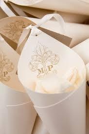paper cones wedding. white rose petals in paper cone with wedding monogram cones