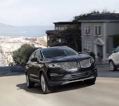 2018 lincoln build and price. fine build the 2018 lincoln mkc is seen ascending a hill in city setting for lincoln build and price