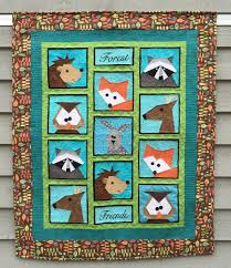 """Forest Friends  Paper Pieced Quilt and Table Runner - Made By Marney & """"Forest Friends"""" has been such a fun quilt to design. It reminds me of all  the wonderful woodland walks I took as a child on the farm. Adamdwight.com"""