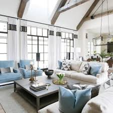 exle of a transitional open concept light wood floor living room design in nashville with white