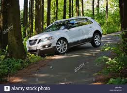 Saab 9-4, SUV, crossover, forest, road Stock Photo, Royalty Free ...