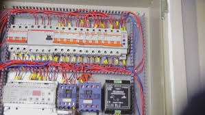 electrician hands checking circuit breakers in electrical fuse box house fuses types at How To Check Fuse On Breaker Box