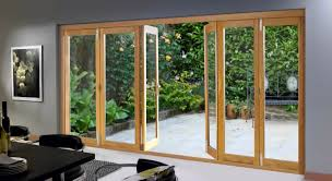 bi fold glass exterior doors with wooden frame for small backyard and dining area ideas