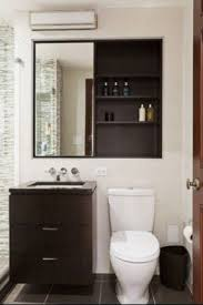 cabinets over toilet in bathroom. small bathroom ideas - smaller mirror, shelves above toilet, bright cabinets over toilet in