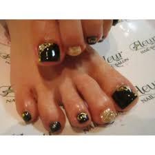 フットネイル黒ゴールド ネイルサロン Fleurフルールのネイル