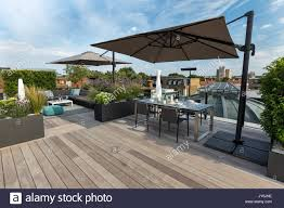 roof deck furniture. Luxurious Roof Terrace In London With Hardwood Timber Decking, Contemporary Planters Lush Planting And Modern Outdoor Furniture Deck N