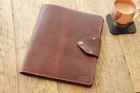 Interior Brown Leather Personalized Padfolio On Wood Table For