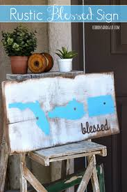 diy rustic blessed sign made from a painted and stained wood board that is personalized with