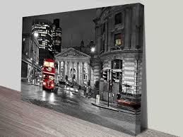 on black and white with a splash of red wall art with london red double decker bus black and white city scene wall art
