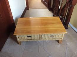 wood and wicker coffee table with storage drawers