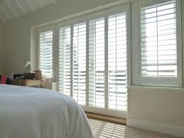 shutters on french doors image of wooden shutters for french doors bedroom wooden shutter blinds for
