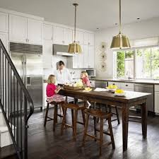 kitchen island table combination. Inspiration For A Timeless L-shaped Kitchen Remodel In Austin With Stainless Steel Appliances, Island Table Combination