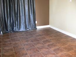 brown tile allure vinyl plank flooring matched with white wall plus white baseboard molding for home interior design ideas