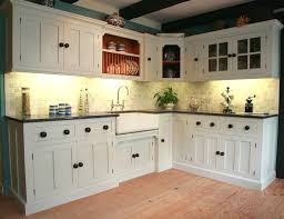 white country cottage kitchen. Ceiling Beams And White Kitchen Cabinets With Under Cabinet Lighting For Country Cottage Designs