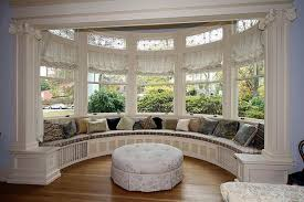 Curved Window Seating Bench With Round Table And Cushion And Laminate  Flooring