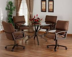 swivel tilt caster gl top dining set by tempo furniture the set is available in choices of fabric and metal finish