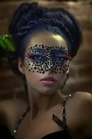 black jewels are used to make a unique masquerade mask