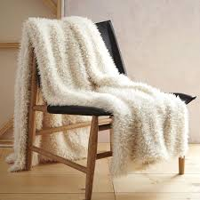 sheepskin throw for chair 5 essentials to make your home ultra cozy for the holidays sofa ikea faux fur chair throw
