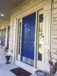 front exterior door sherwin williams duration paint blue front door blue shutters tan brick home sw dress blues color