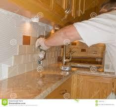 Ceramic Tile For Kitchens Ceramic Tile Installation On Kitchen Backsplash 12 Royalty Free