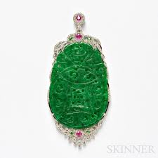 18kt white gold jade and diamond pendant the carved jade plaque within a
