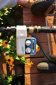 the timer and quick connector attach the watering system to the hose cart
