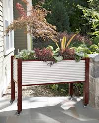 elevated raised garden beds. Self-watering Galvanized Metal Elevated Raised Garden Bed Planter Box On Casters Planted With Ornamentals Beds