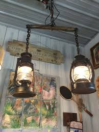 hanging light made from old lanterns and a horse yoke rustic lighting old lanterns lanterns and horses