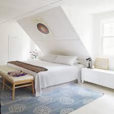 Crisp White Bedroom With Sloped Ceiling