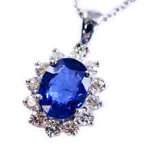 oval blue sapphire diamond pendant in 14kt white gold