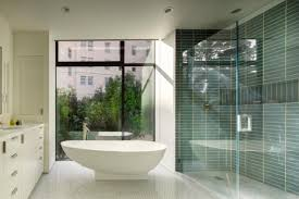 sleek modern bathroom with freestanding tub glass shower