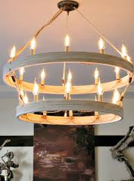 bring a fantastic wooden touch to your interiors with this double ringer chandelier that is made of two wooden hoops having diffe sizes