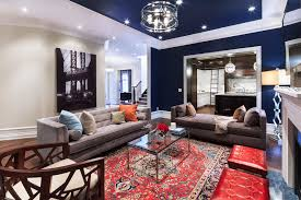 accent rug living room contemporary with fireplace mantel midnight blue modern sofa