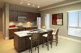build kitchen island sink: black kitchen island with granite tabletop and wooden barstools also wonderful pendant lamps and white wall