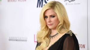 avril lavigne releases emotional single head above water after long battle with lyme disease abc news