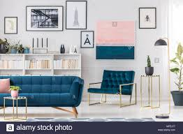 Modern blue couch Midnight Blue Modern Living Room Interior With Blue Couch Armchair Golden Tables And Paintings On The Wall Snegpriceclub Modern Living Room Interior With Blue Couch Armchair Golden Tables