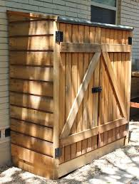 storage shed with wood slats on the sides feet wide 5 feet high and 28 inches deep hook eye combo latch 2 ikea bygel hang bars hanging small tools and
