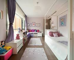 Example of a trendy girl kids' bedroom design in Other with pink walls