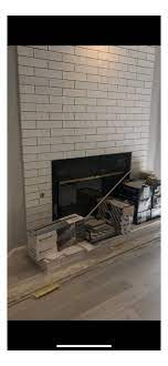 mount a tv on tile wall above fireplace