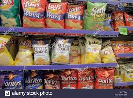 making potato chips stock photos making potato chips stock miami beach florida walgreens pharmacy drug store retail display shopping for products packaging shelf shelves