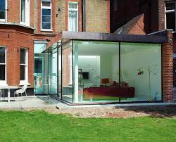 Contemporary glass extension to Grade 2 listed mansion block in Hampstead  ...