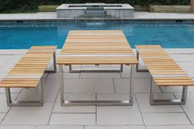 the table and bench may be used together independently or in combination w stainless steel dining chairs see tivoli made w wide planks of premium