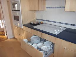 even if you have a small kitchen the way you use the space will really make a difference use pullout drawers for storage and garbage can space