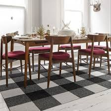 this area rug features made you look in black bone and mica this area rug contains quad cut tiles to emble your rug just use the flordots in the box