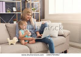 home office multitasking. Home Office Multitasking. Happy Beautiful Business Mom Working On Laptop In While Her Multitasking