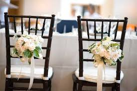 wedding chairs with flowers