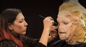 an artist creating a demonic mask on face off