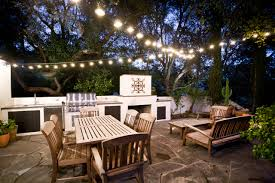 outdoor terrace lighting. Outdoor Kitchen Designs With Patio Lighting Ideas And Fireplace Dining Furniture Plus Stone Pavers Potted Plants Terrace O